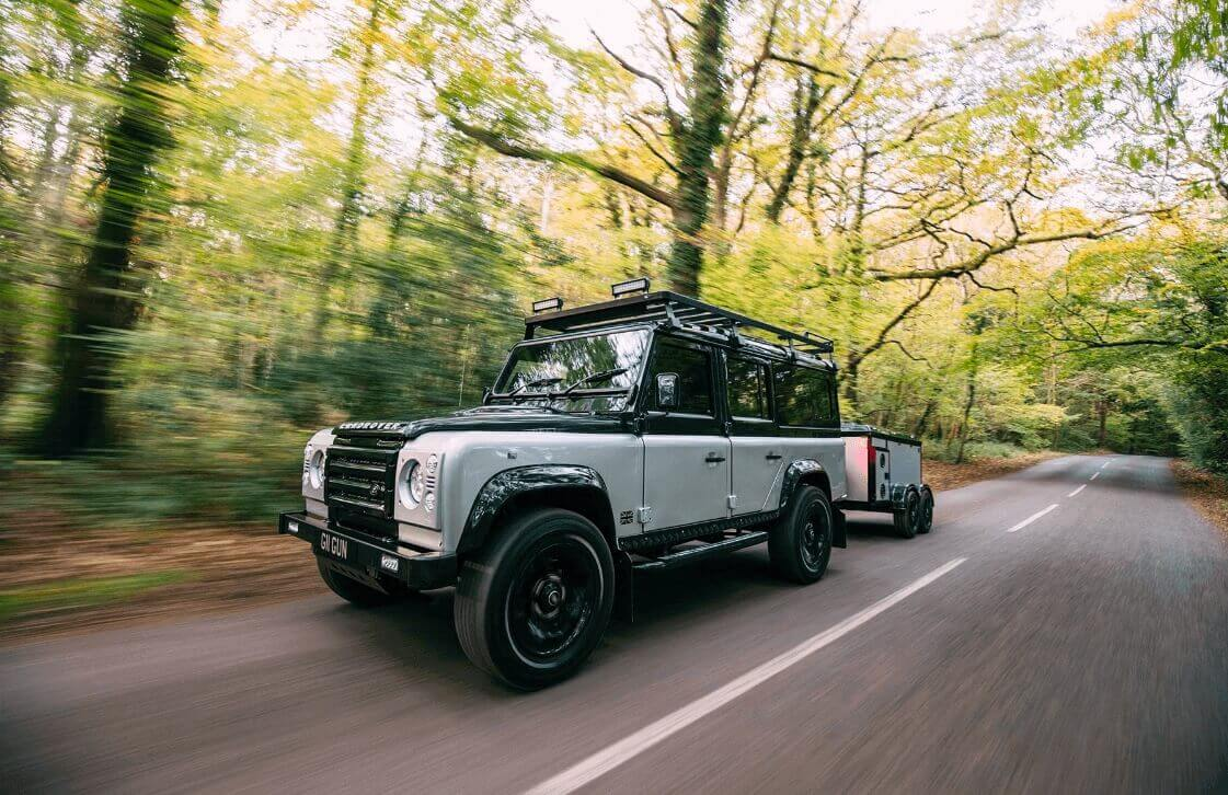 Grey & Black Landrover on the Road